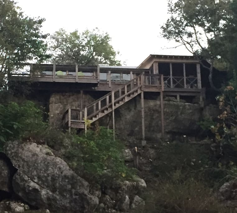 Back of our river front home built on a huge stone bluff, right on and overlooking the beautiful Medina River!