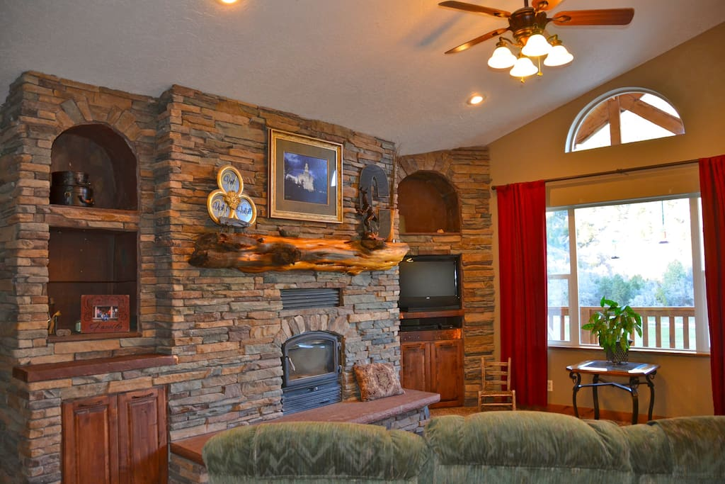 Spacious and peaceful gathering room with wood burning fireplace.