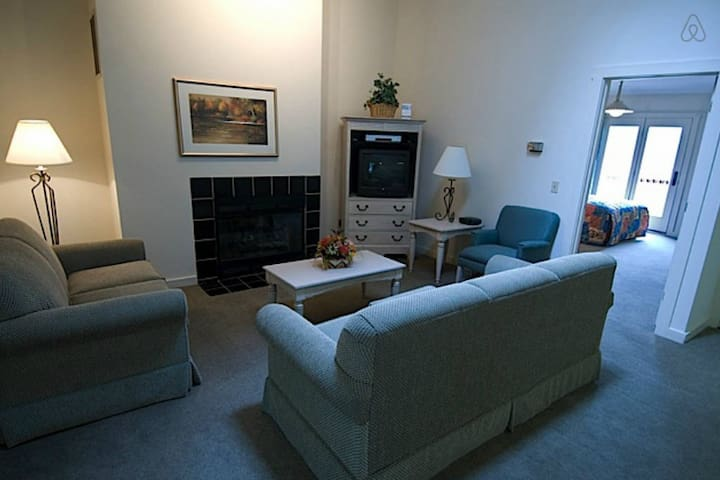 Sample living room. Exact unit is assigned upon checkin.