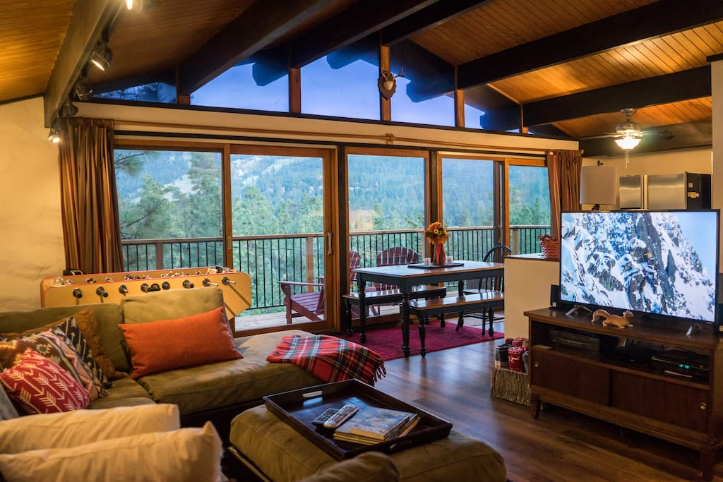 Current photo shows our new flooring, deck railing. and 4k smart TV.
