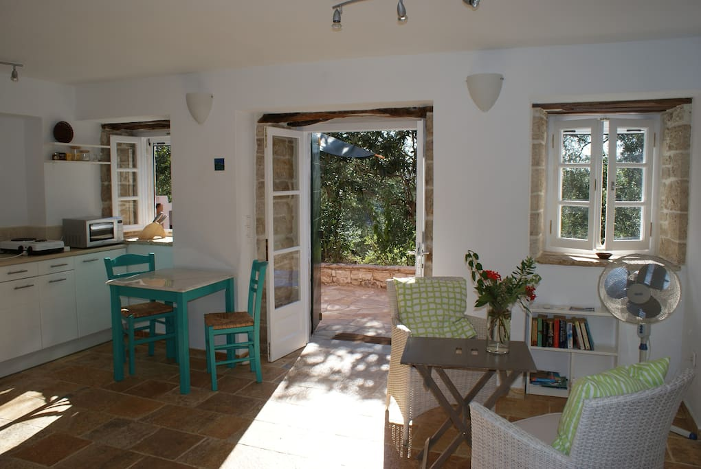 Light and airy kitchen and sitting area of Studio Adriana, overlooking the garden.