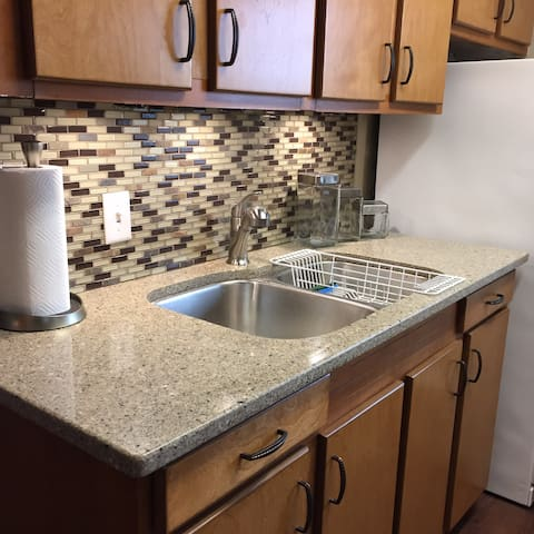 Loft D, 2 bedroom unit . Kitchen with granite countertops. Dishes, pots and pans provided.