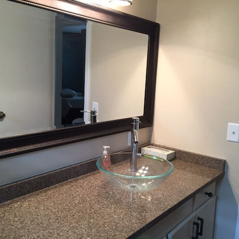 Loft D Bathroom with granite countertop amd vessel sink