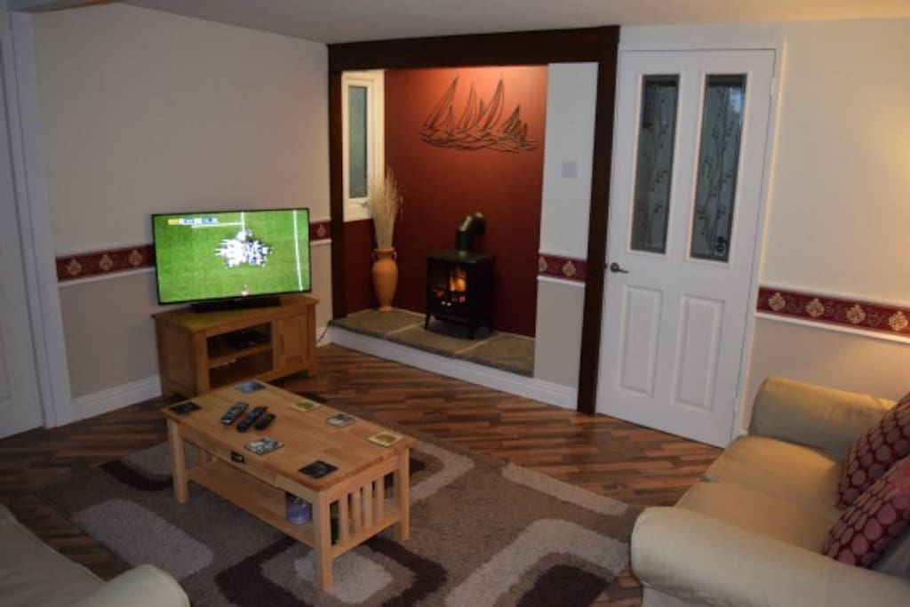 Large comfortable lounge with large screen HD Tv