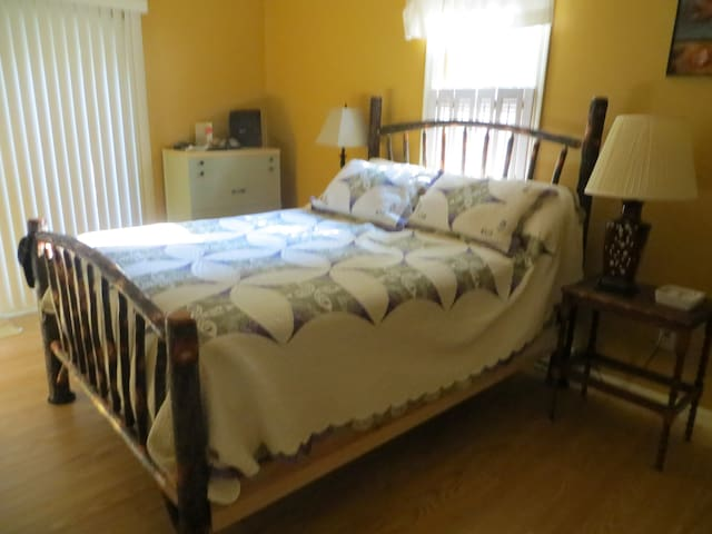 Master bedroom with queen size bed.  Full master bath