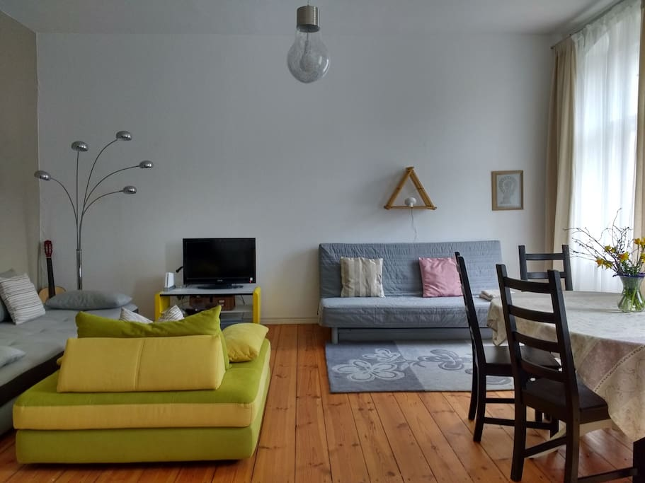 Living room is huge and has a lot of space and light. It comes with dining table for six and comfortable sofa bed (can be transferred into another bedroom)
