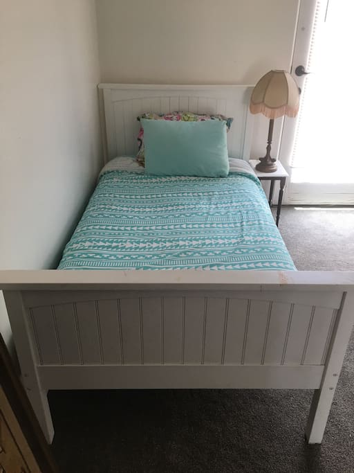 Comfy twin bed, recently updated with a new Sealy Beautyrest mattress!