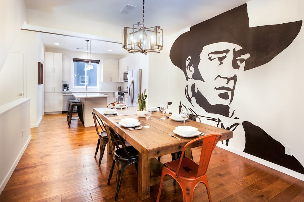 The farmhouse table now has 10 chairs and 3 bar stools!   Check out this Ultra Modern feel with the influence of the Old West!!!
