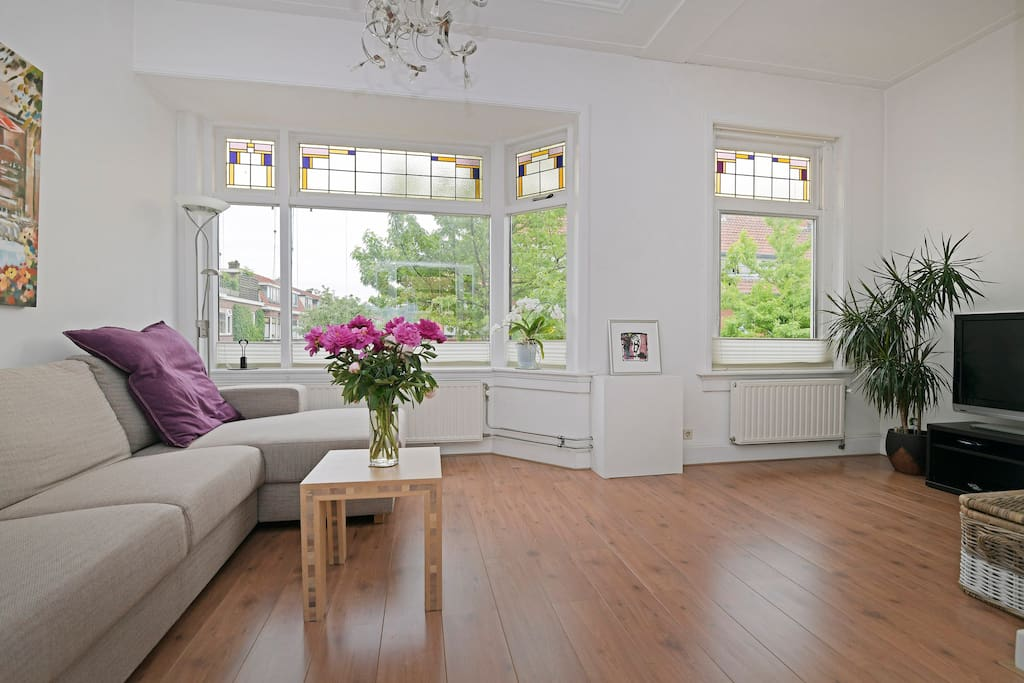 Front living room with stain-glass adorned windows and 180 degree view