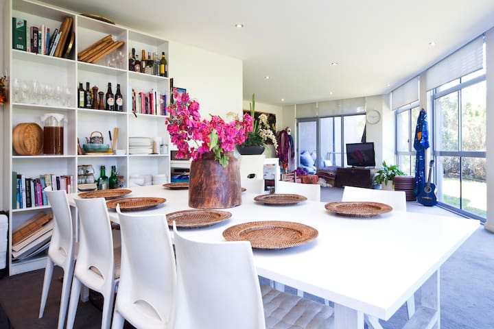 8 seater dining table with view through to the TV and lounge area.