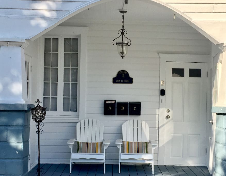 Front porch. Comfortable adirondack chairs beckon you to sit and enjoy the sunset. The Master Lock key holder is located on the left beside entry door.