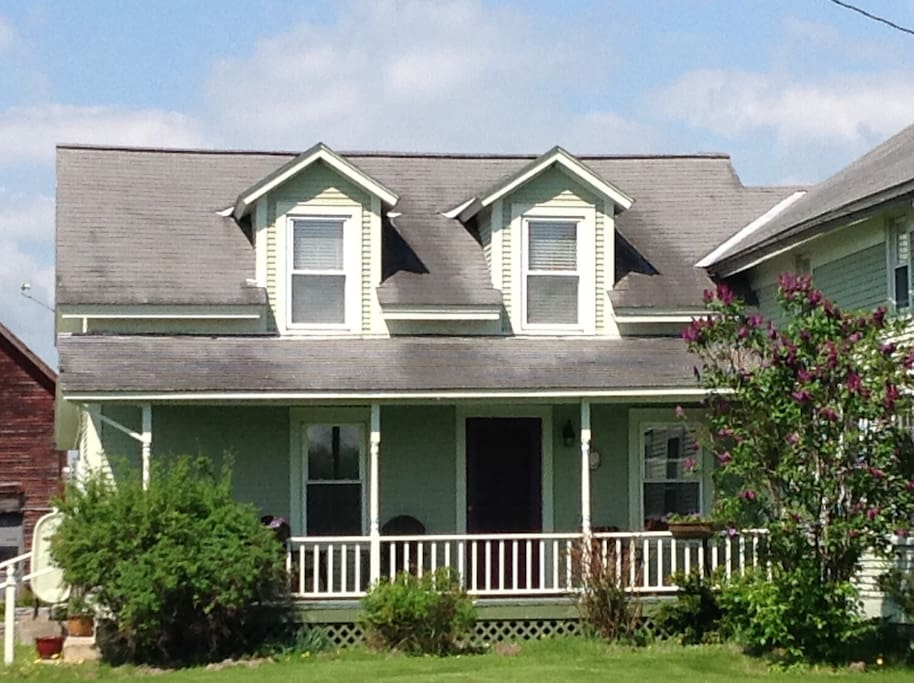 Newly renovated late 1800s farmhouse in-law suite with private front porch  entry.