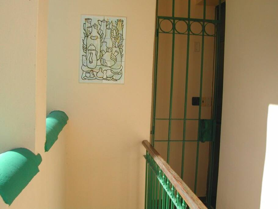 The door to the apartment, to the right, the dark glass door.