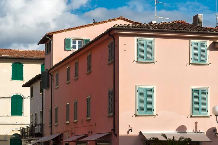 The building and the top floor looking towards the sea: bedroom window