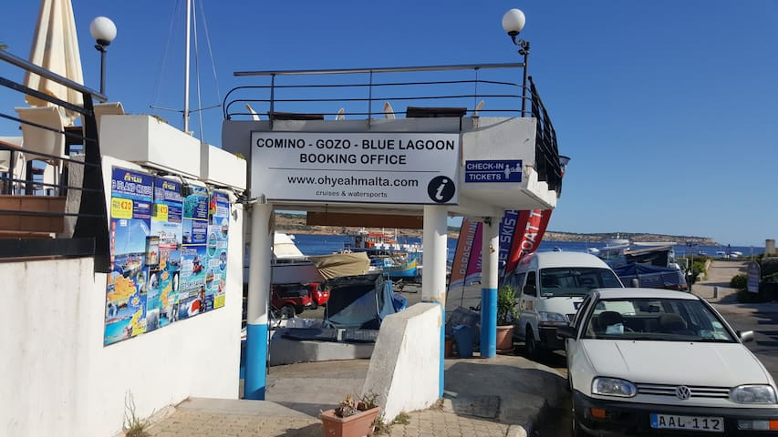 Local excursions ticket office and Padi diving center near house.