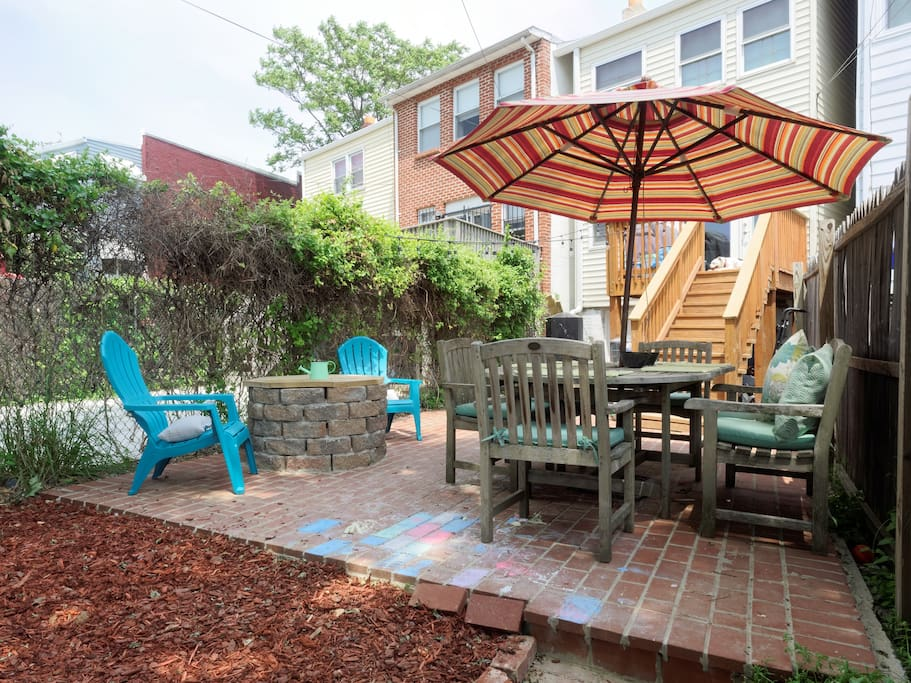 Backyard offers sun or shade. Table seats six comfortably. Fire pit features two Adirondack chairs. We recently built a treehouse, with a swing and hammock below for all to enjoy! There is also a sandbox and splash pool and lots of toys to go around!