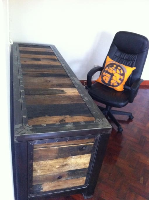 Large,  locally made desk. Located opposite living room area.