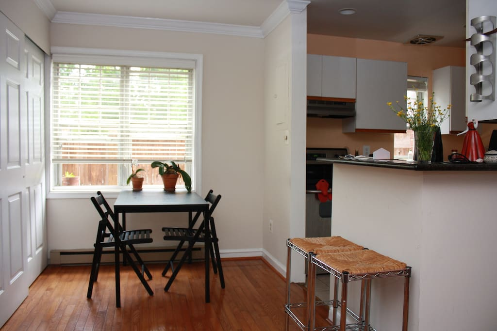 Dining area (washer/dryer behind folding doors)
