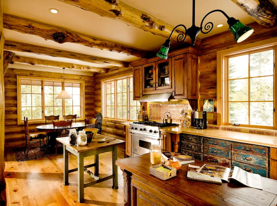 Kitchen/dining with viking stove and two sinks.