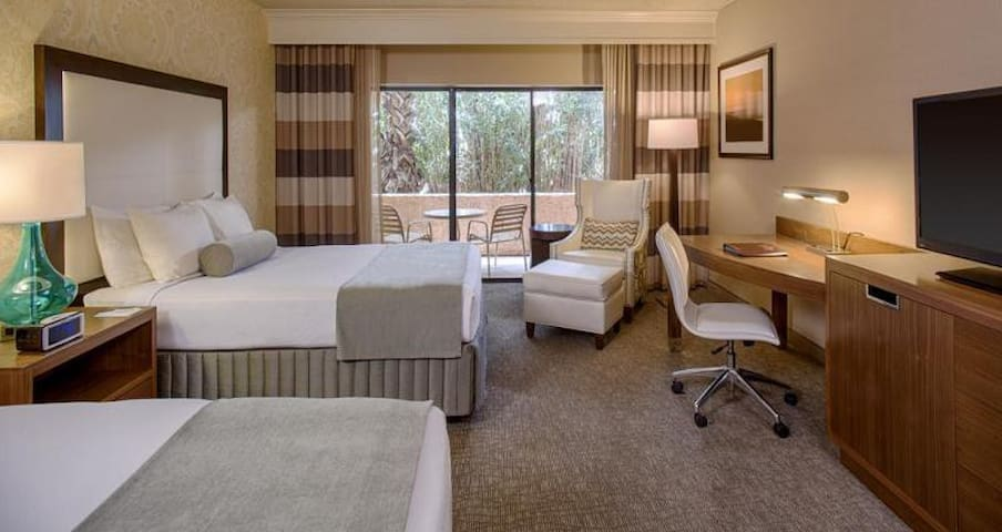 Modern and spacious room with two comfy Queen beds