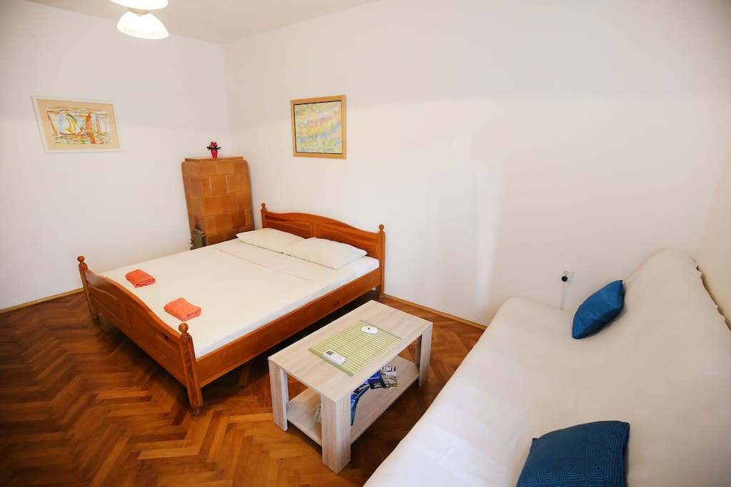 Bedroom with double bed and sofa