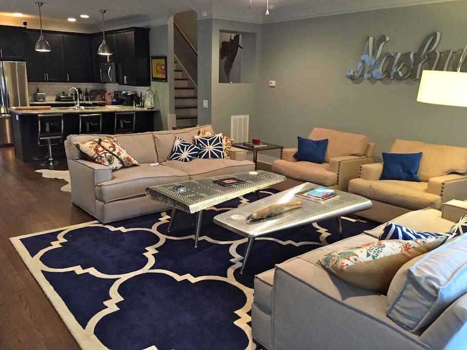Space is open concept and meant for entertaining and large group enjoyment. Two large airplane wing coffee tables for games/drinks/food.