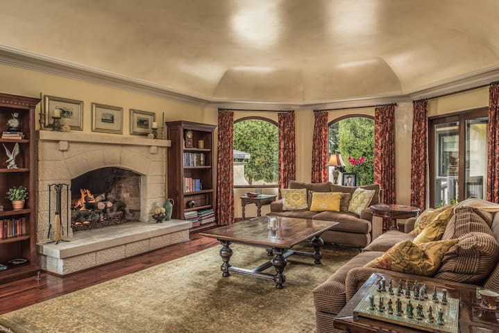 Gorgeously detailed living room with gas fireplace and seating for 5.