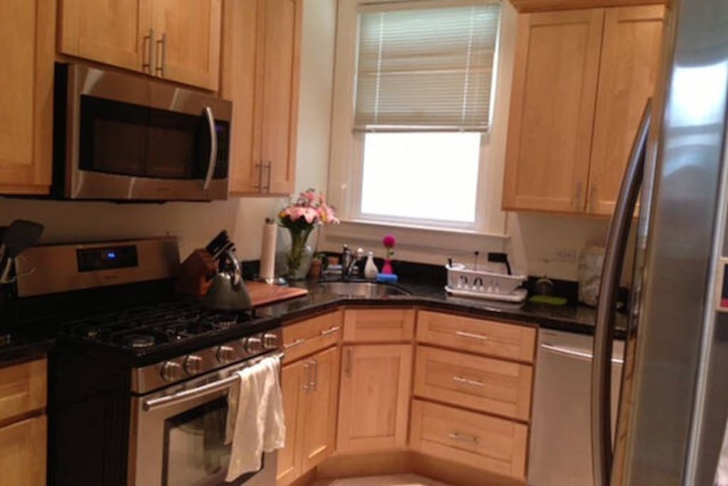 Updated kitchen with  stainless steel appliances including gas range and granite countertops.