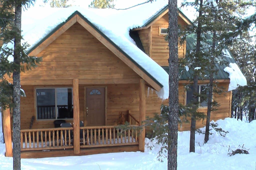 Winter scene of the cabin front