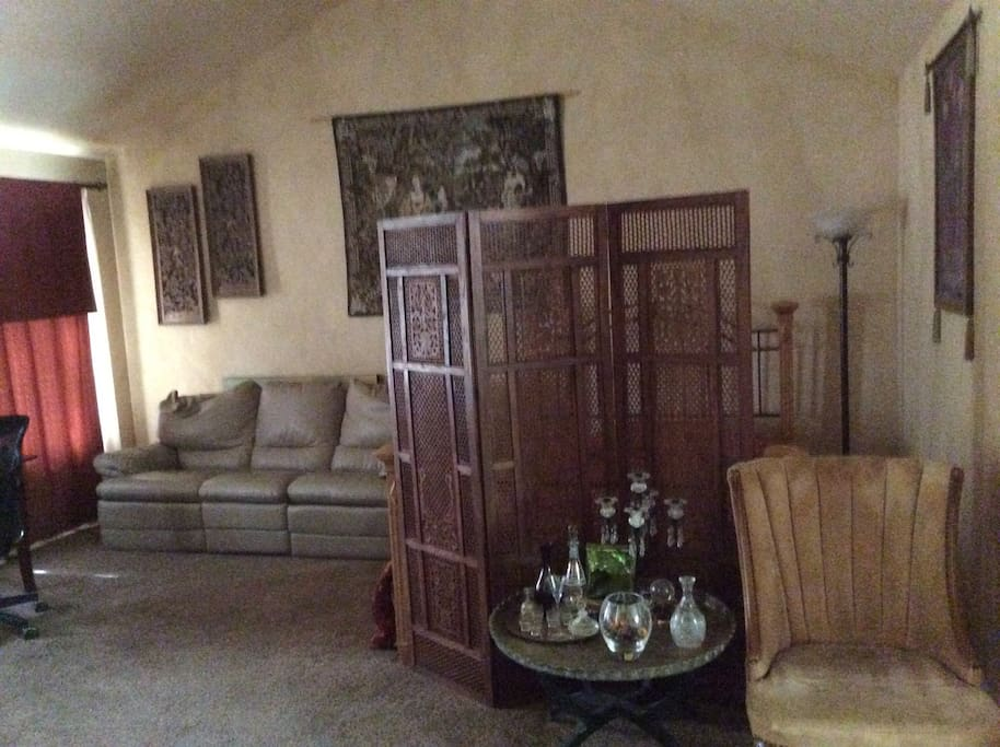 Living Room w/ spate queen bed behind screen
