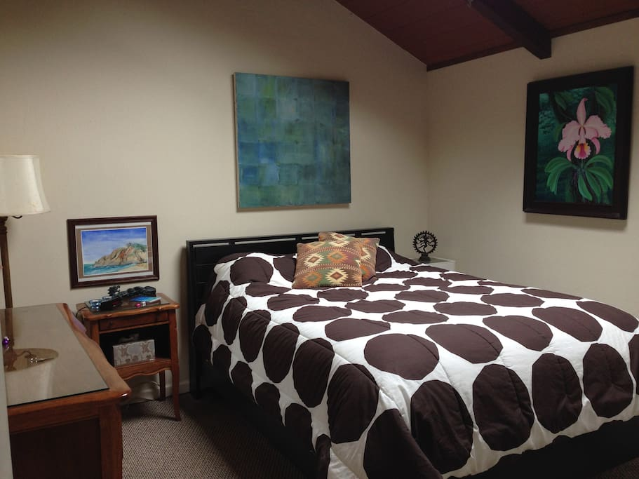 Quiet ample sized room with comfortable queen bed & skylight.