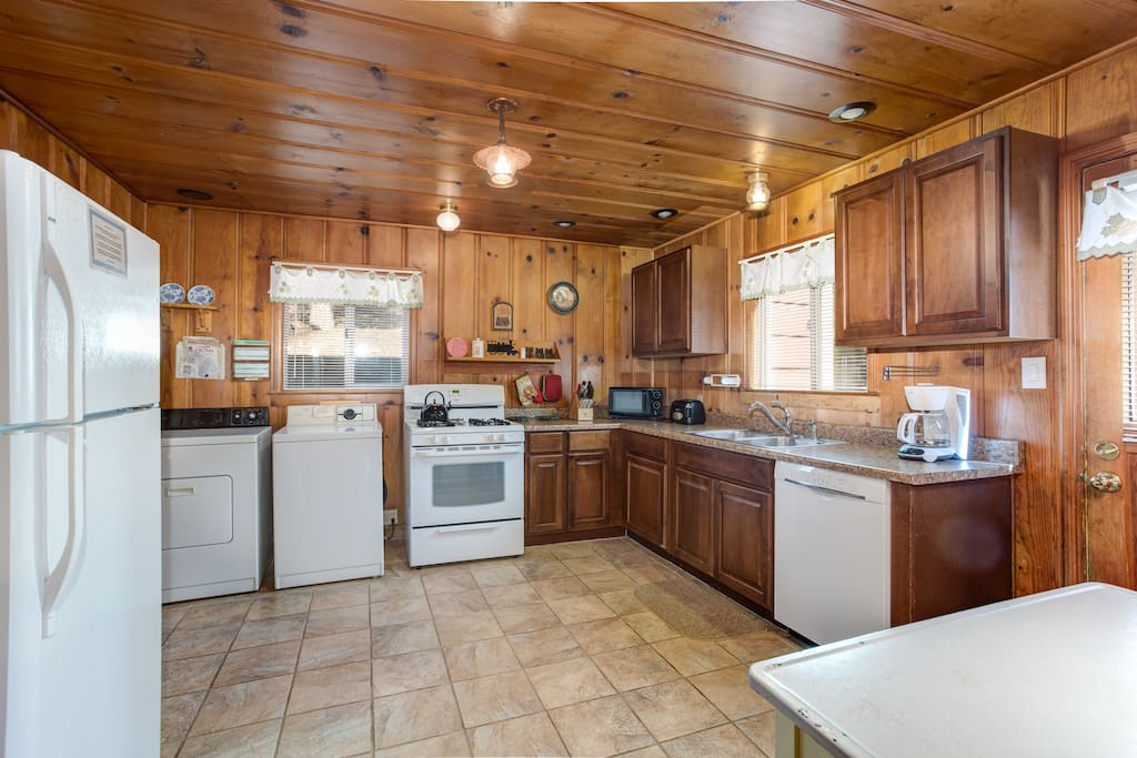 Kitchen with dishwasher, gas stove