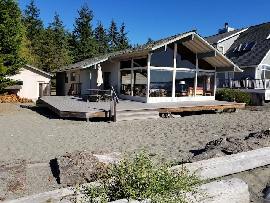 Lovely vacation home on a sandy beach at Mutiny Bay in Freeland, WA.