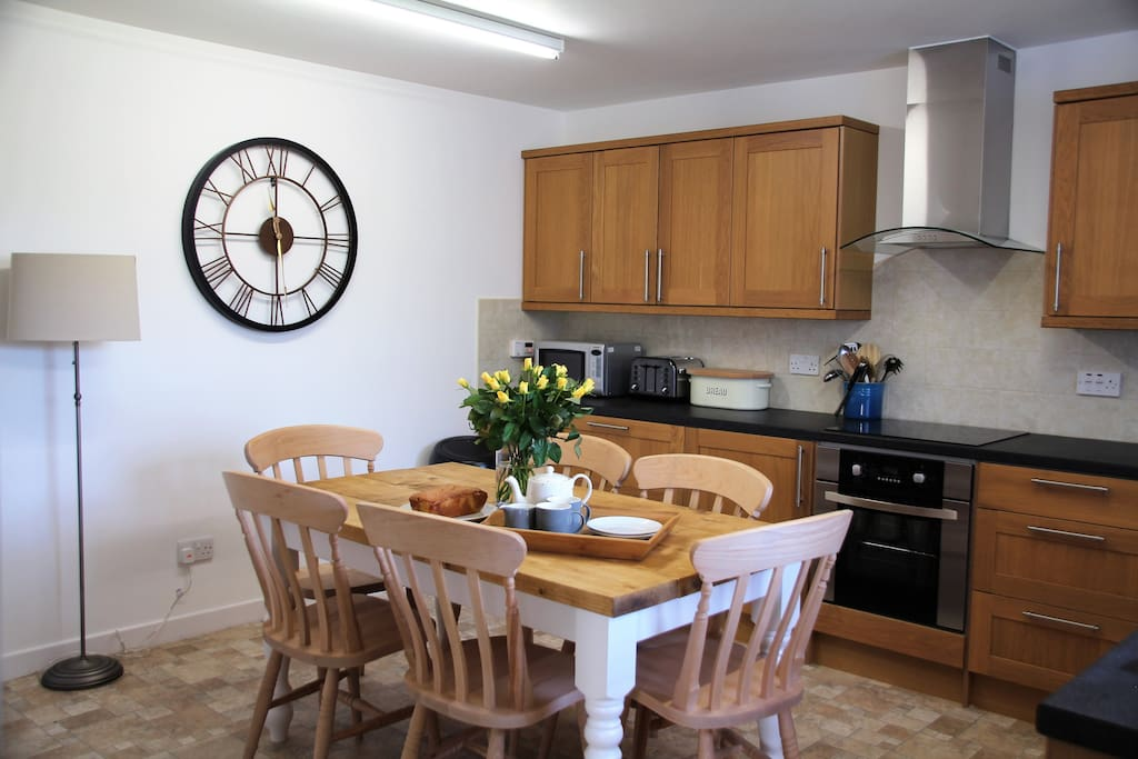 Well equipped farmhouse kitchen with induction hob, microwave and dishwasher