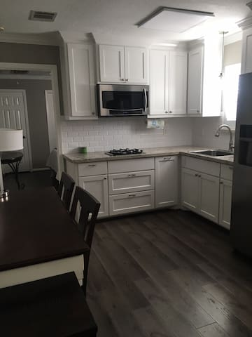 Kitchenette with gas cook top, microwave with convection oven, refrigerator with ice maker.