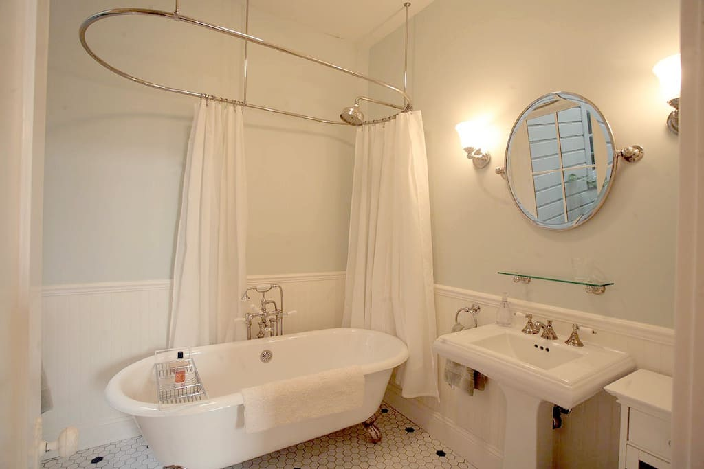 "Your private bath has a ""rain"" shower-head over a clawfoot tub."