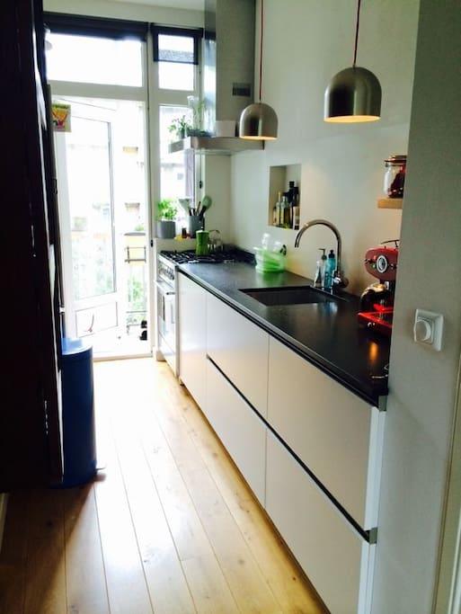 Kitchen, including Illy Coffee machine, large fridge, dishwasher, oven and