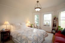 Your sunny bedroom includes all the comforts of home... Sofa, dresser, closet space.