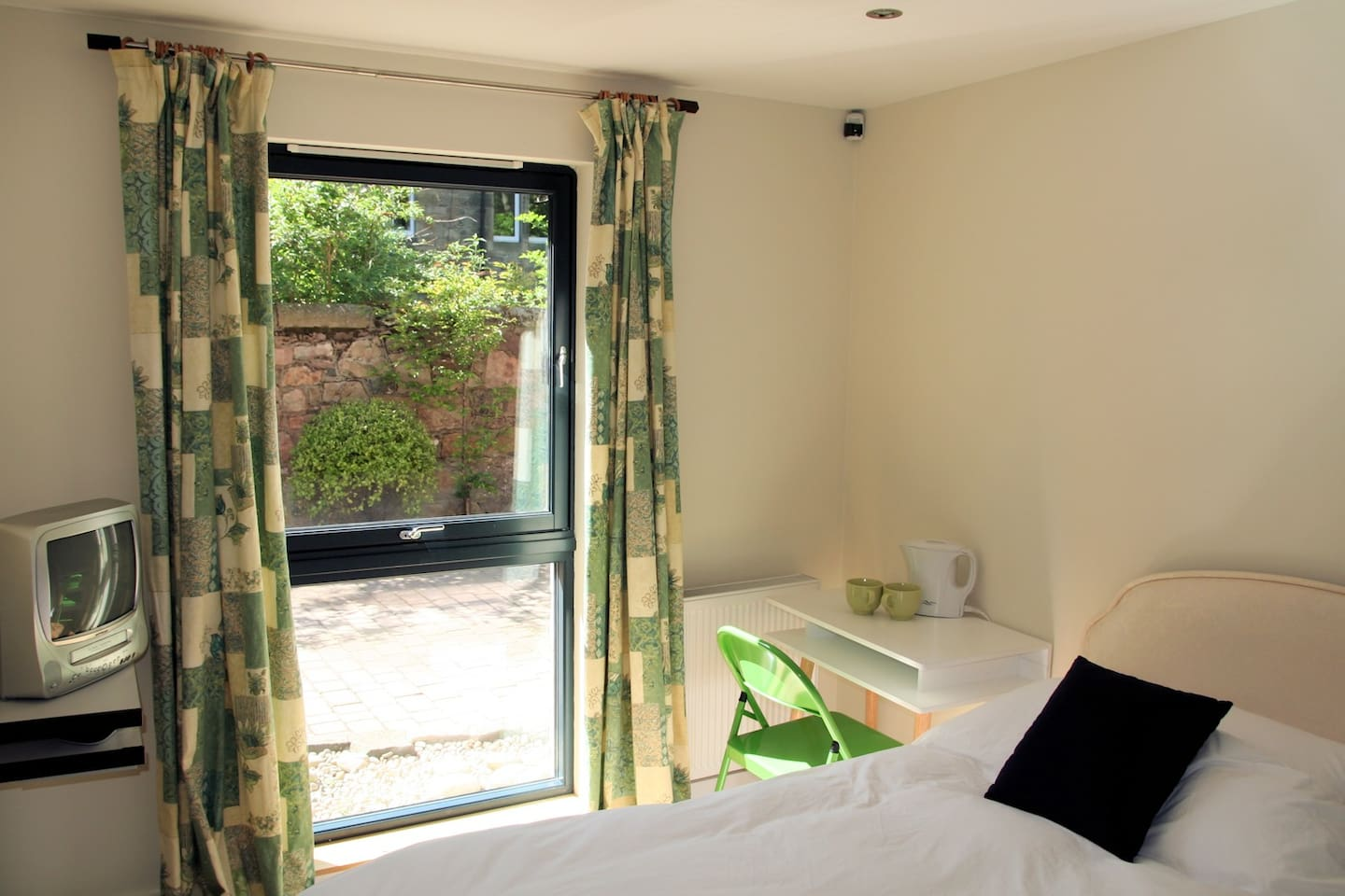 A lovely sunny room with a view of traditional tenements