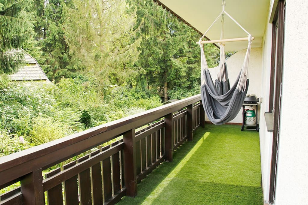 Balcony has artificial grass that feels nice under foot.  Additional there are 2 single person hammocks and a gas BBQ.