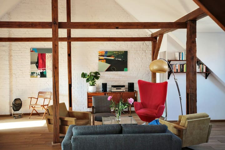 Bright, colourful space, filled with light, art, flowers, books & design,