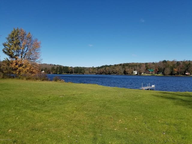 Expansive lake front lawn for all kinds of activities, games and events!  Swimming area easy access for all ages. Pristine water!