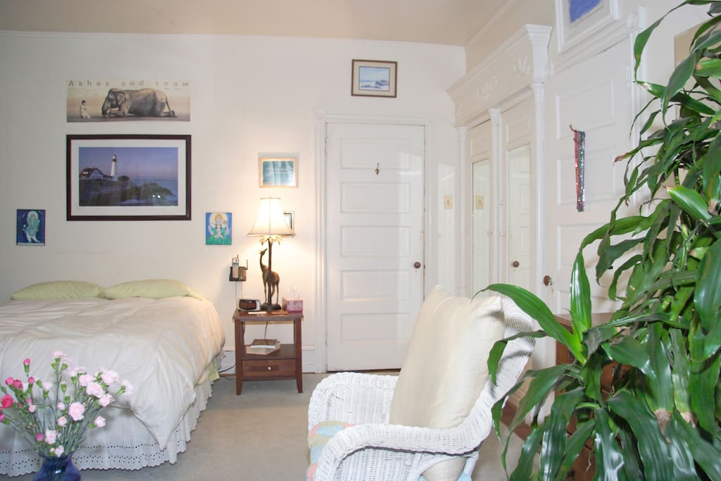 The Guest room - soft and welcoming- also has a closet .