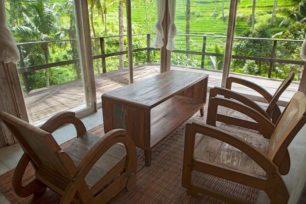 Unique teak wood furniture in our living space with our own rice terrace view.
