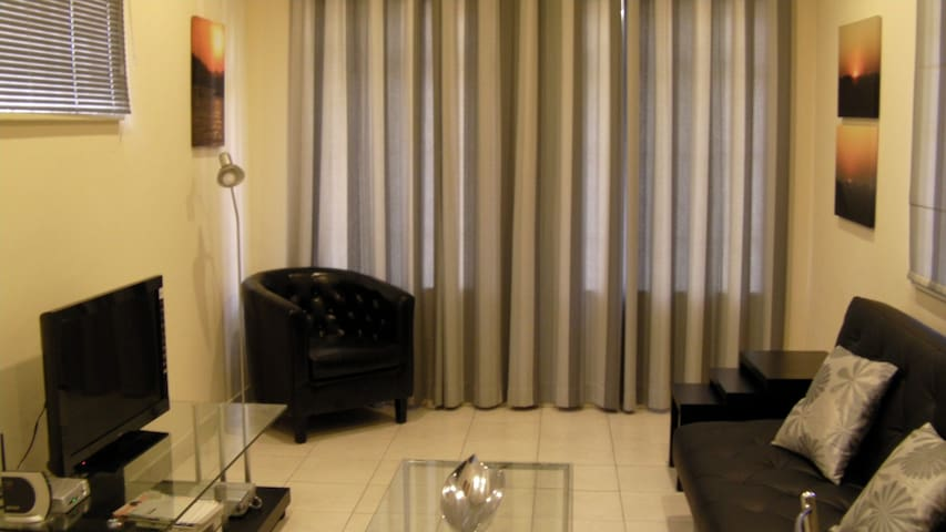 Your own lounge with TV and DSTV Connection