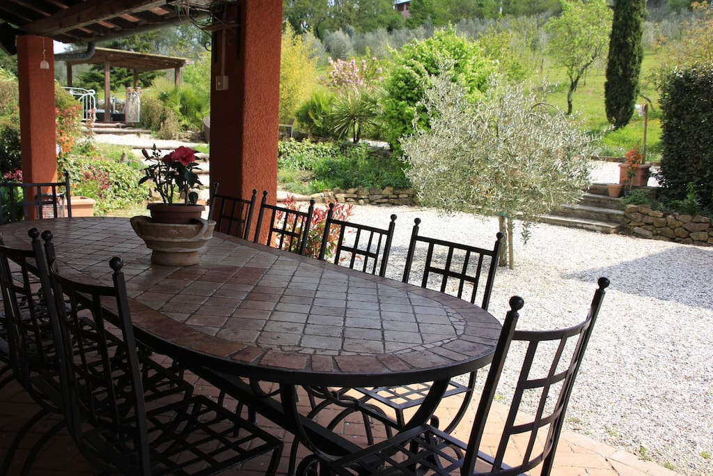 A table that seats 10 is just outside the kitchen for al fresco dining.