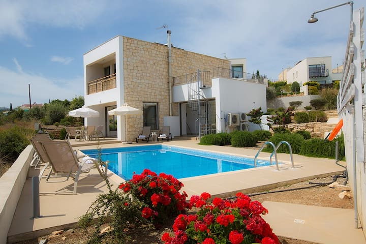 Outside area with barbecue, seating area, sun loungers, outside shower and private pool