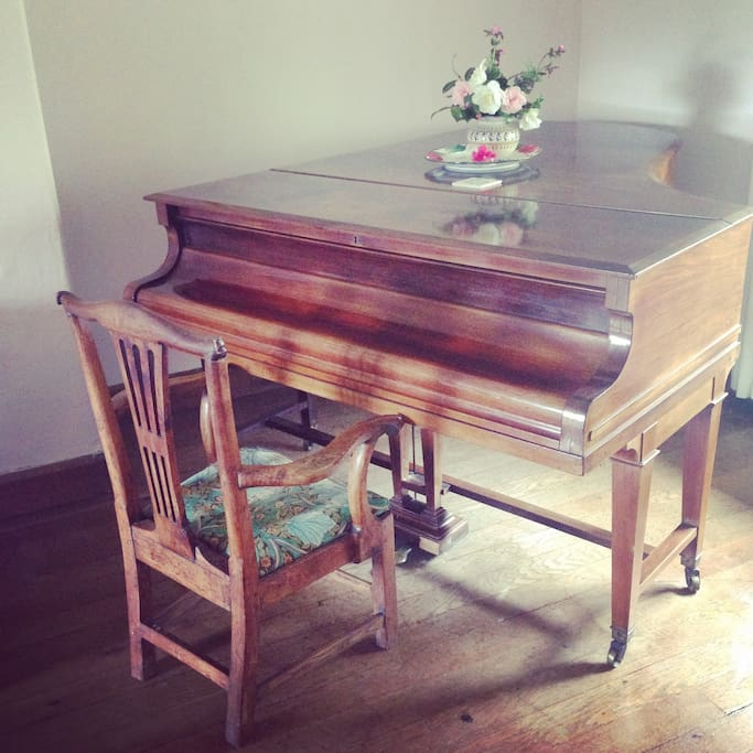 The grand piano in the sitting room