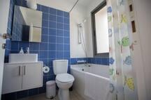 En suite bathroom with bath, shower and WC