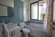 En suite bathroom 2 with bath, shower and WC